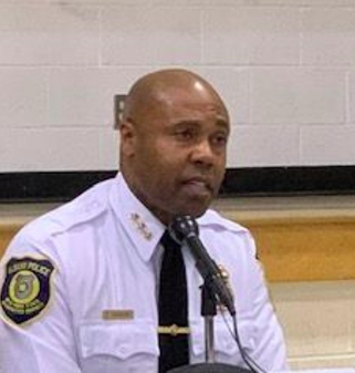 Police Chief Eric Hawkins holds an open discussion with several community members about police abuse within the urban community of Arbor Hill and the South End.